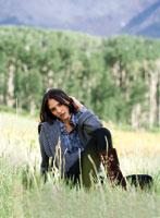 a woman sitting in a field