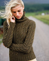 a woman in a brown sweater