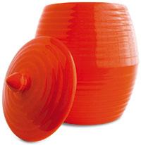 an orange ceramic dish