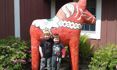 Boy with dala horse at Gammelgarden Museum