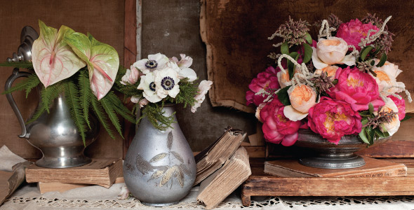 Floral arrangements in metal containers