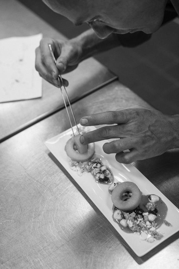 Chef Hakan Lundberg of The Minneapolis Club plating