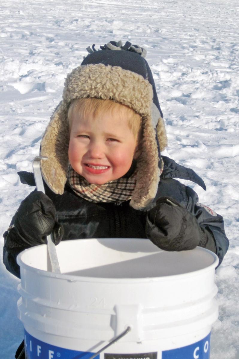 Ice fishing little boy