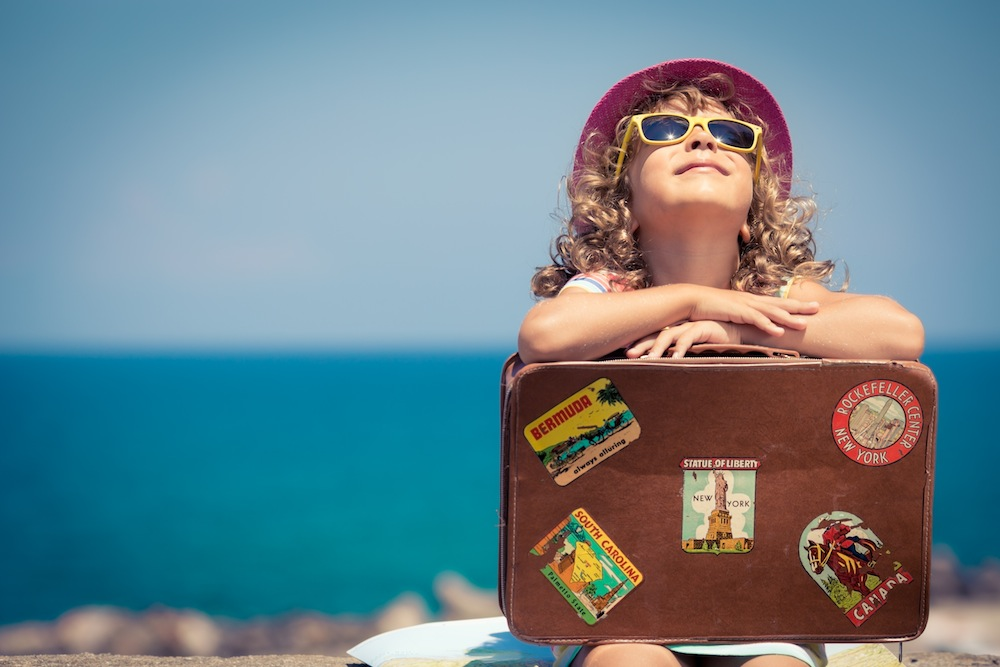 Child on Vacation with Suitcase