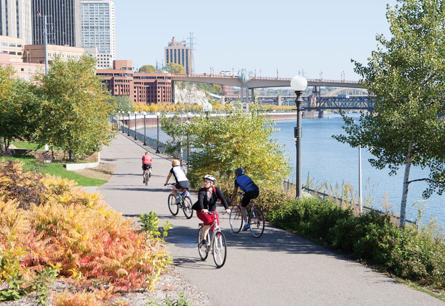 Bikers cruising along the St. Paul riverfront along West Seventh.