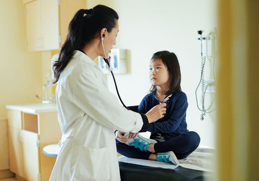 Dr. Judy Eckerle, head of University of Minnesota's Adoption Medicine Clinic, treats a patient.