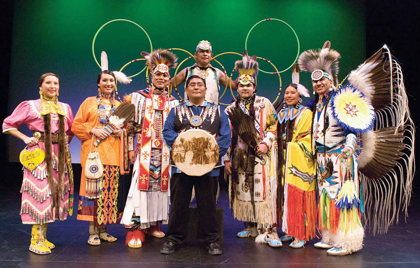 A group of people dressed in traditional Native American garb for the annual Flint Hills International Children's Festival.