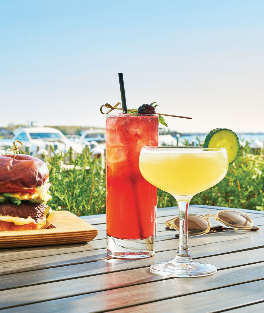 A table displaying fruity cocktails alongside a cheeseburger at 6Smith in Wayzata.