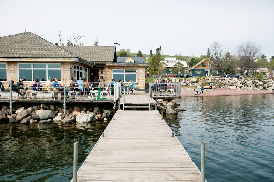A portrait of the patio and dock at Angry Trout Cafe in Grand Marais.