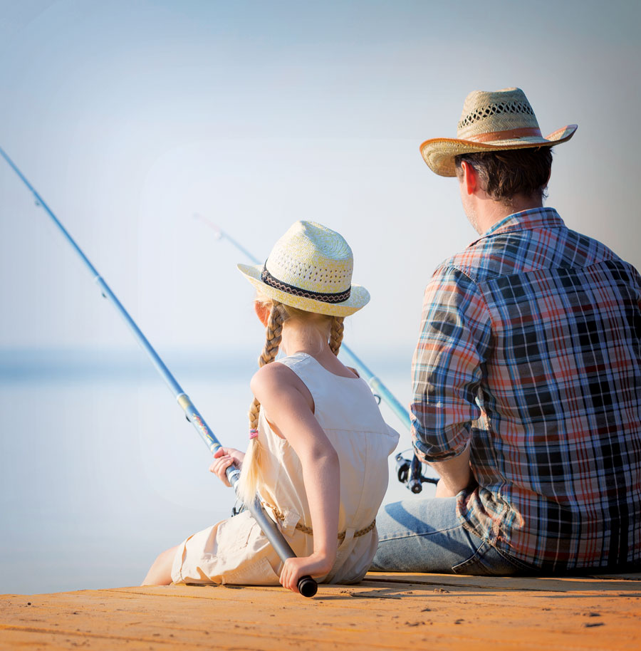 A dad and his daughter fishing.