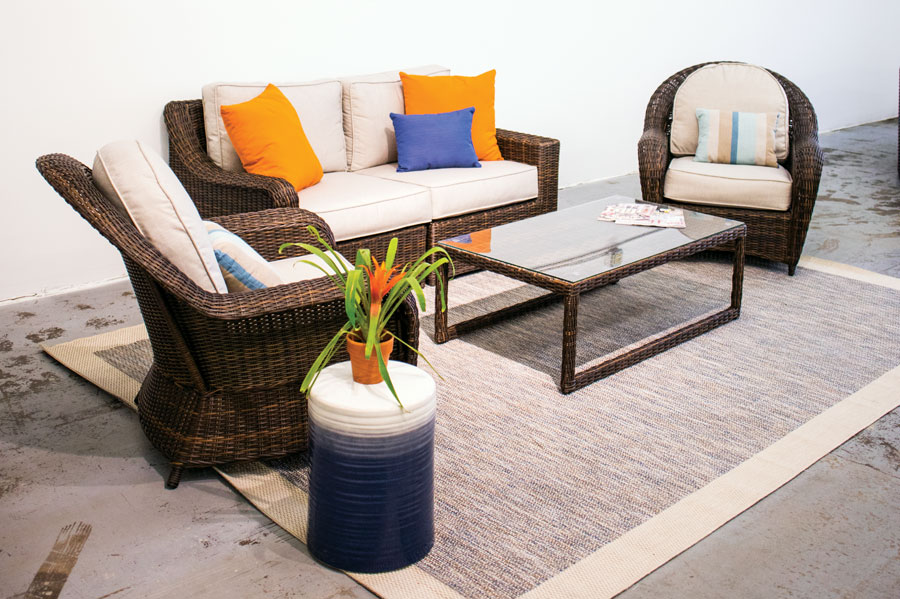 An outdoor furniture set consisting of two chairs, a sofa and coffee table by Yardbird Furniture.