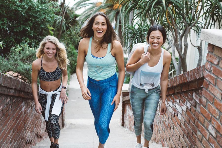 Girls climbing stairs and laughing in Zuma Blu apparel.