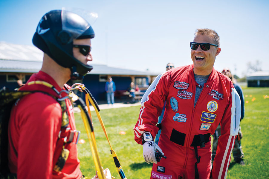 Kevin Burkhart laughing with a friend after landing from a skydive.