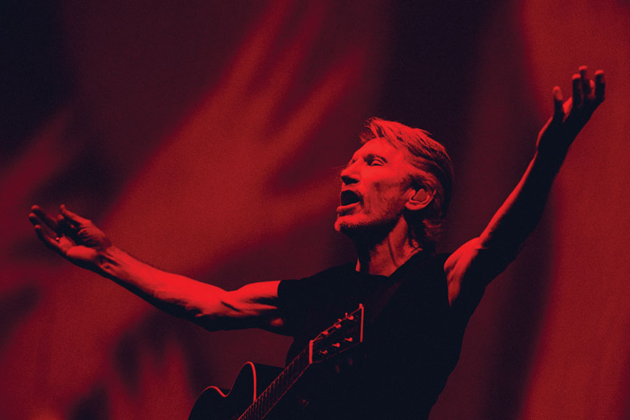 Roger Waters performing on stage.
