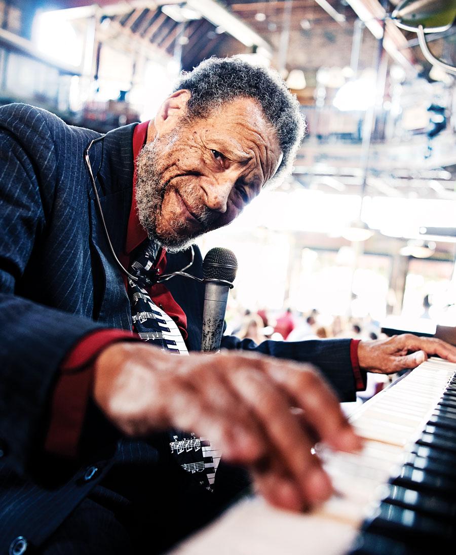 "James Samuel ""Cornbread"" Harris Sr. playing the piano."