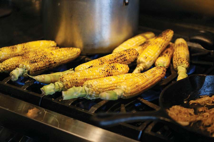 Roasted corn on a grill.