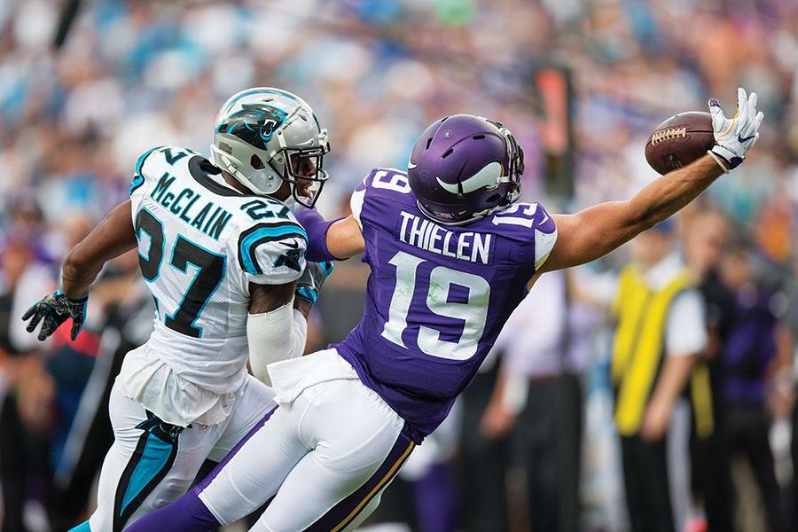 Minnesota Vikings wide receiver Adam Thielen catching a pass.