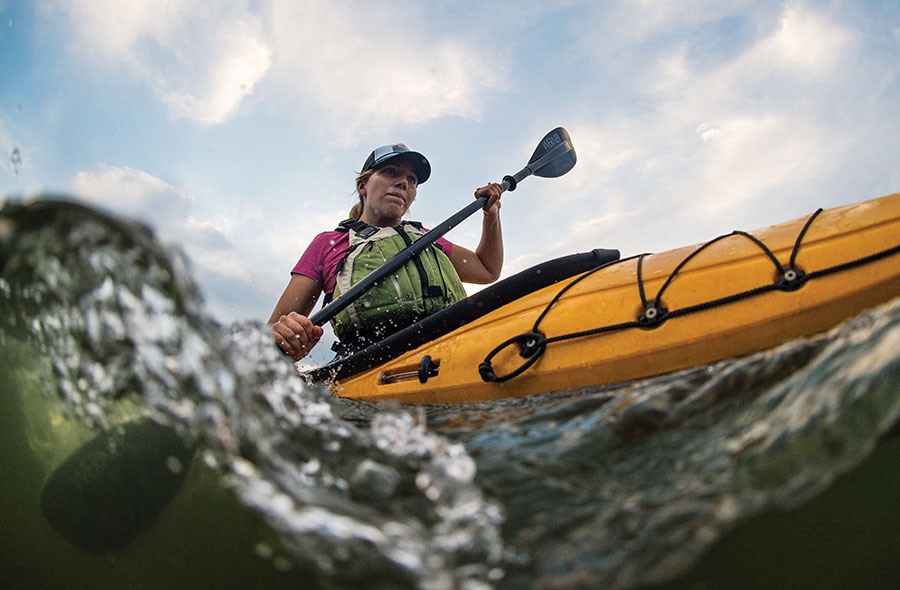 A lady kayaking.