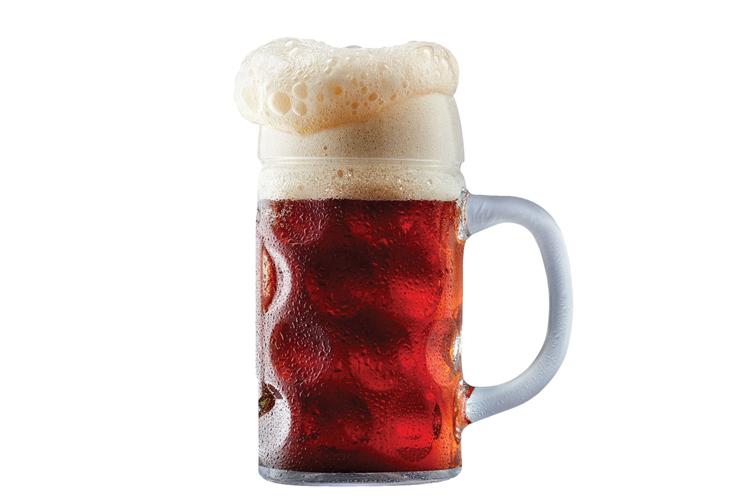 A beer mug overflowing with foam.