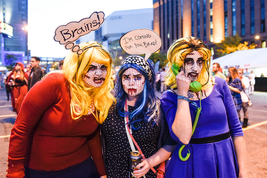 Three girls dressed as zombies at the Zombie Pub Crawl in Minneapolis.