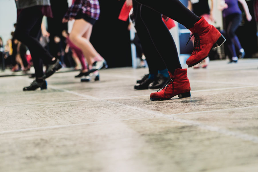 A group of people tap dancing.