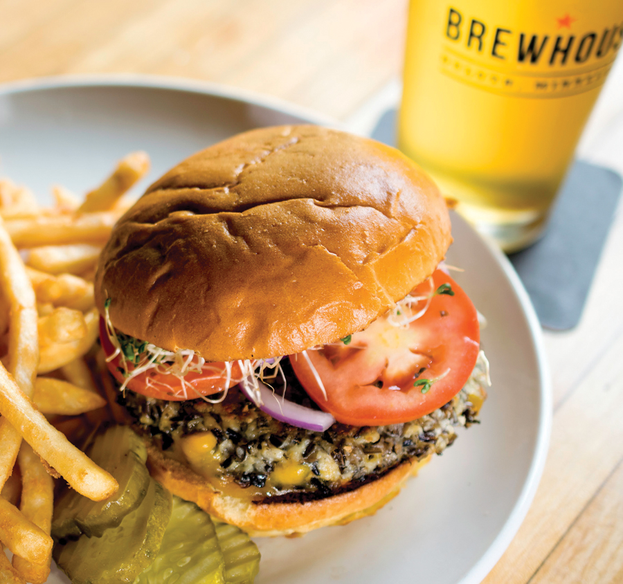 The wild rice burger next to a plate of fries at Fitger's Brewhouse in Duluth. A glass of beer sits next to the plate.