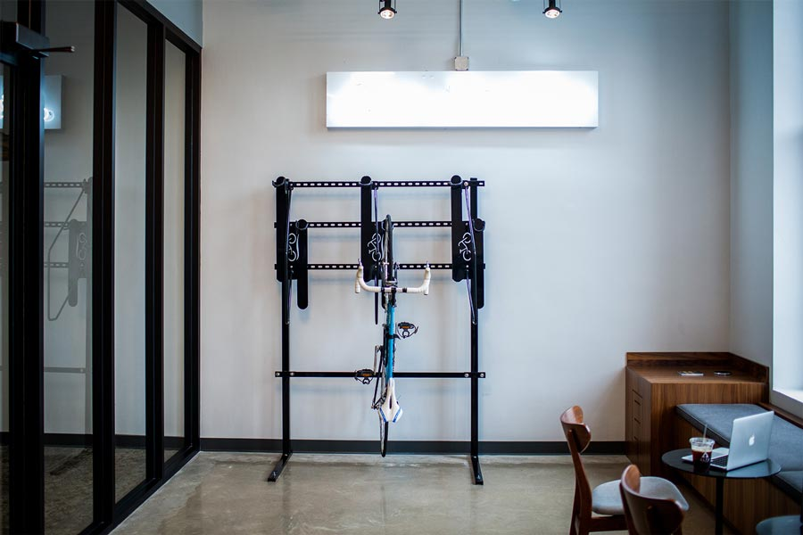 The entryway at ALTR features a bike rack, as well as a place to sit and relax along the wall.