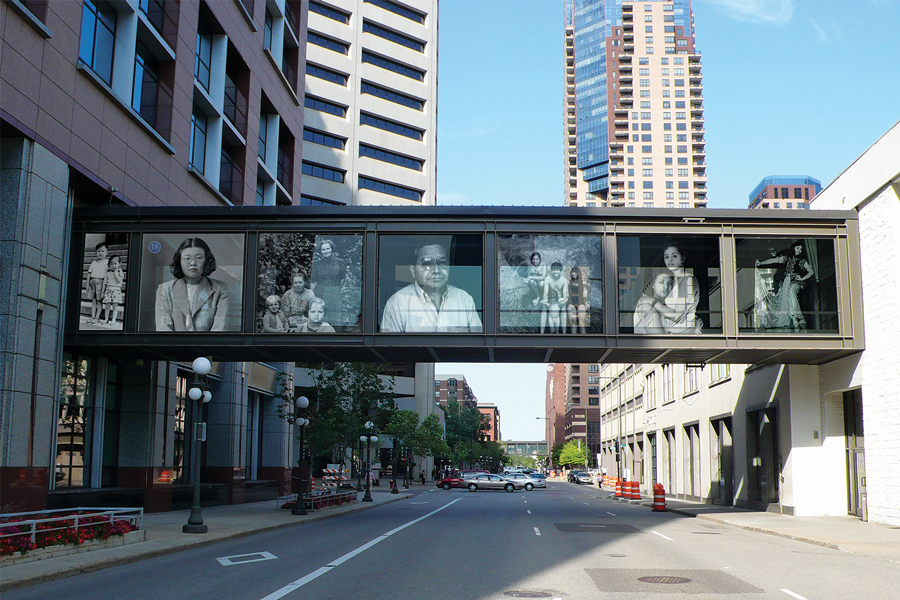 A St. Paul skyway with portraits of Minnesota immigrants on the panels.