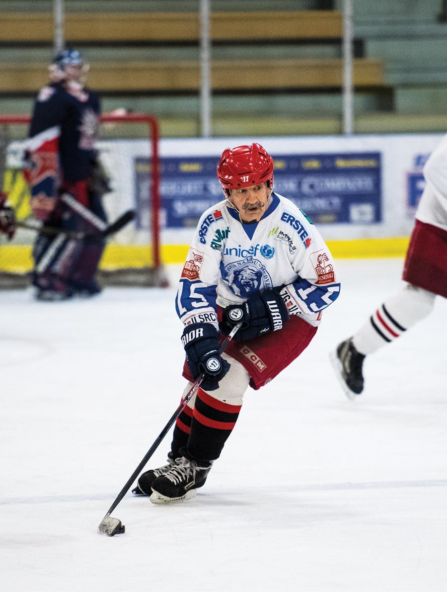 Mark Sertich, the world's oldest hockey player, skating in full uniform.