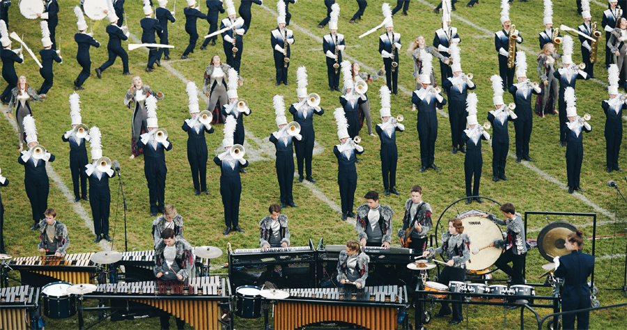 The Rosemount marching band performing during halftime at a football game.