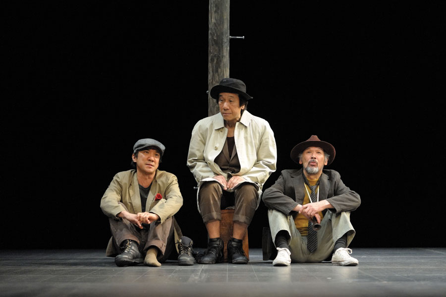 Three men sitting on the floor in a production of Godot Has Come.