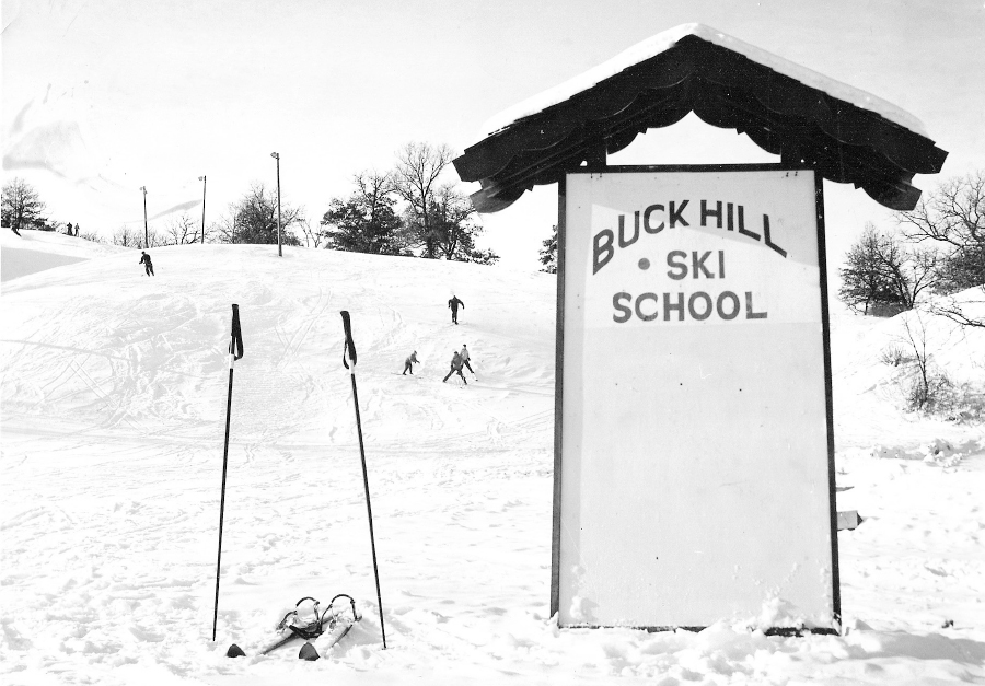 A black and white photo of the Buck Hill Ski School.
