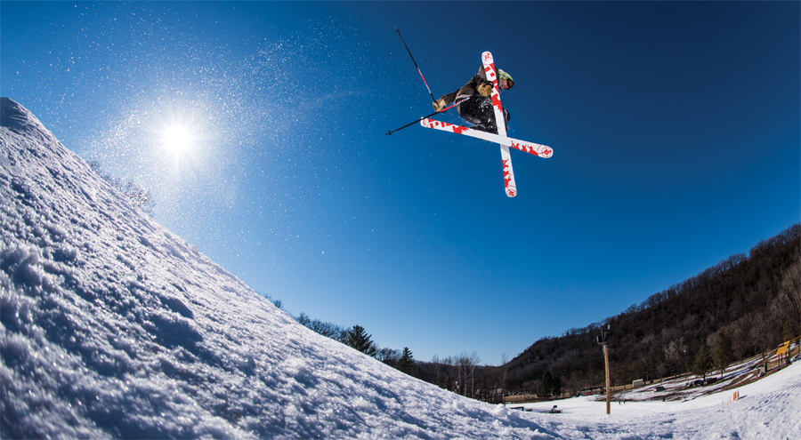 A skier performing a trick after a jump.