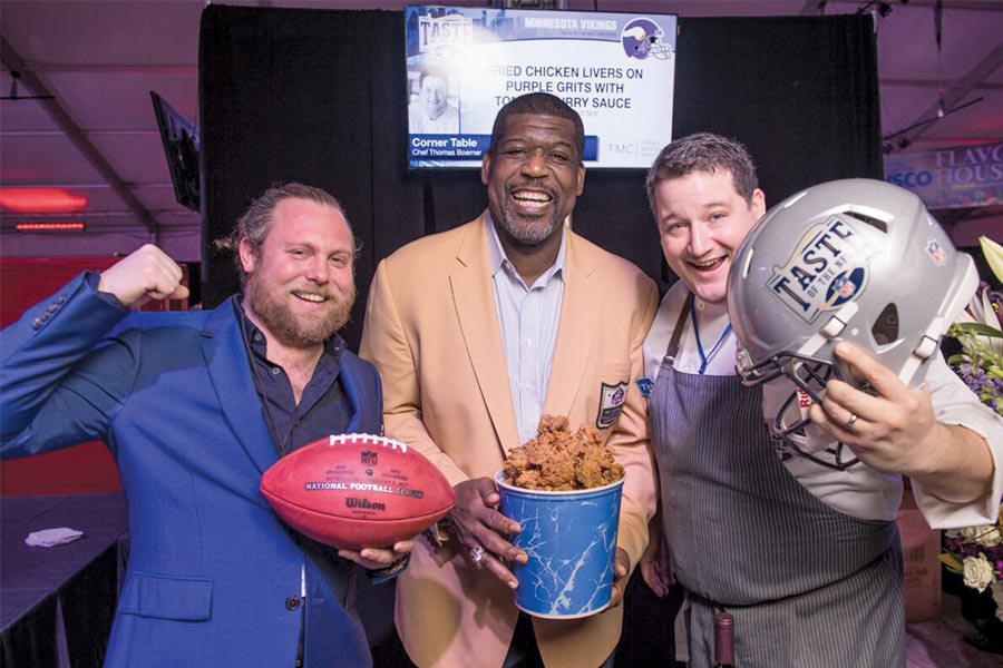 Former Viking Randall McDaniel (holding chicken) with Revival's Nick Rancone and Thomas Boemer.