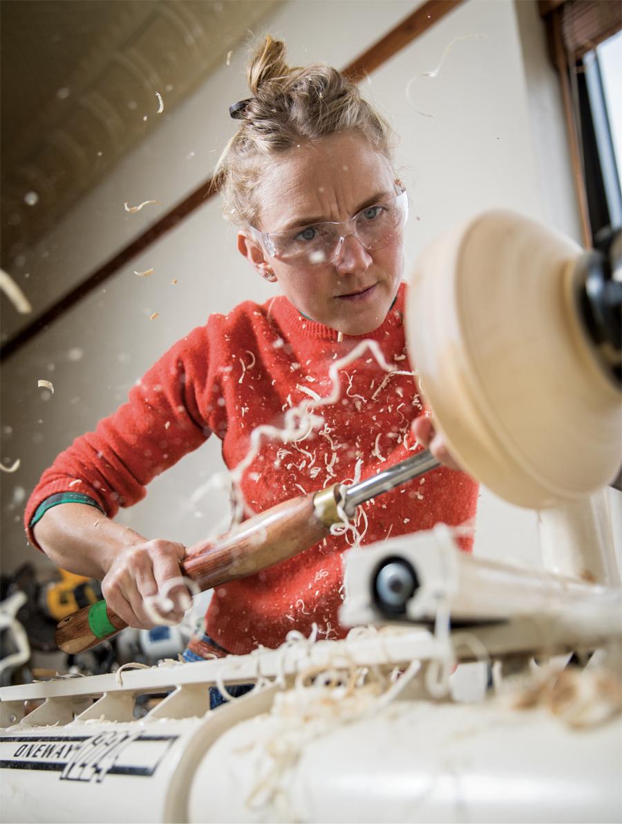 Jess Hirsch shaving wood.