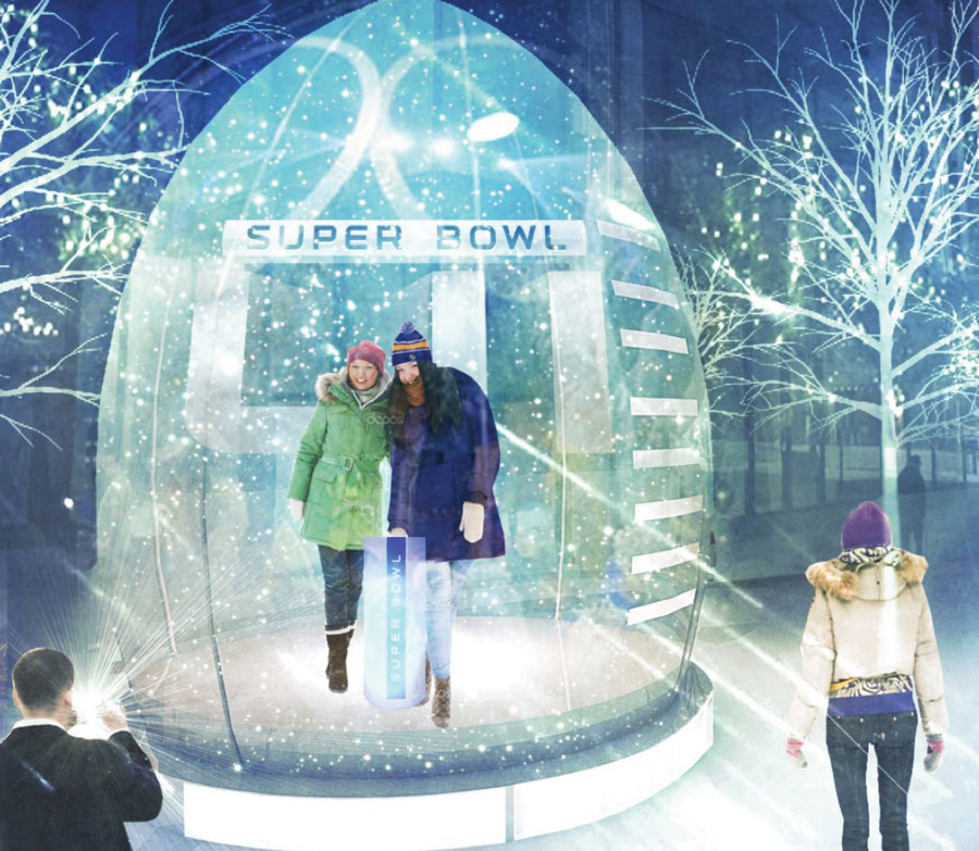 People getting their picture taken inside the walk-in snow globe at Super Bowl LIVE.
