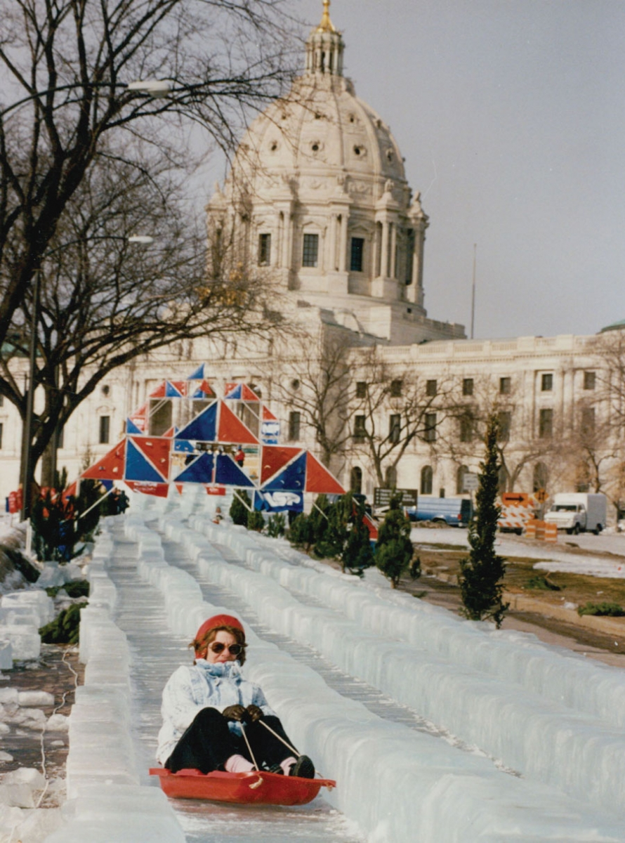 A woman riding down the 1,000-foot ice slide at the State Capitol during the 1992 Super Bowl.