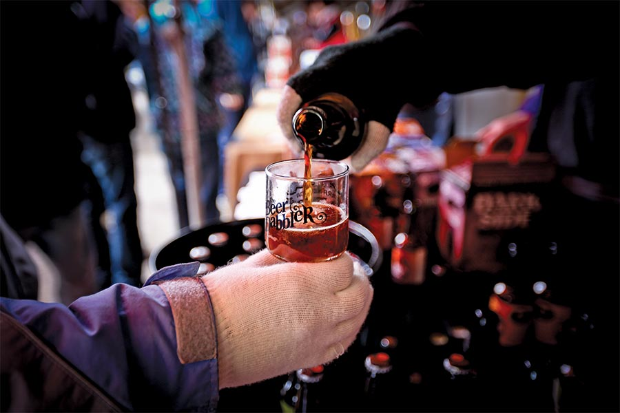 Beer being poured into a glass at the Beer Dabbler.