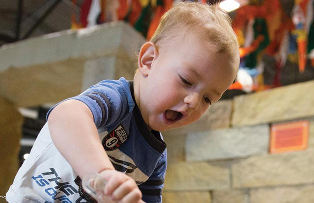 A young boy playing at the Childrens Museum of Southern Minnesota.