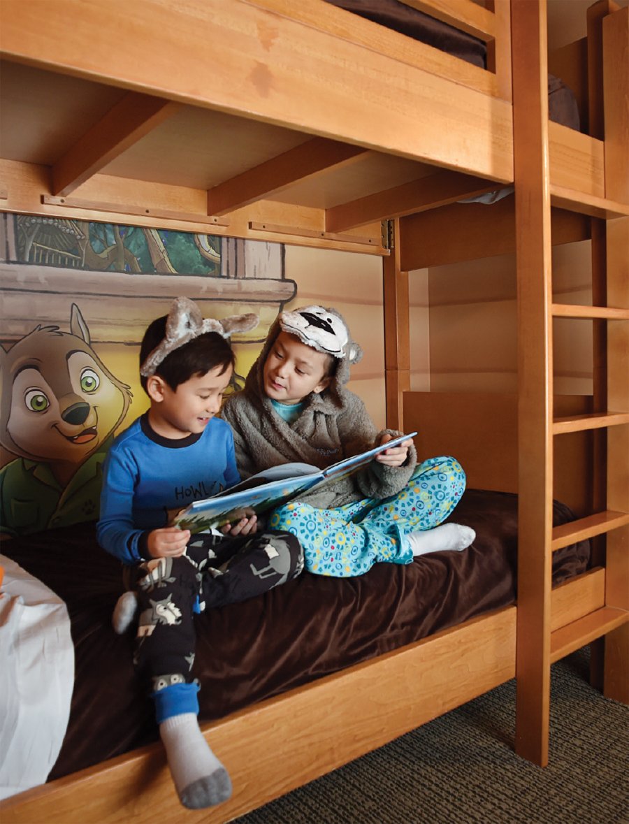 Two children sitting on a bunk bed at Great Wolf Lodge in Bloomington, Minnesota.