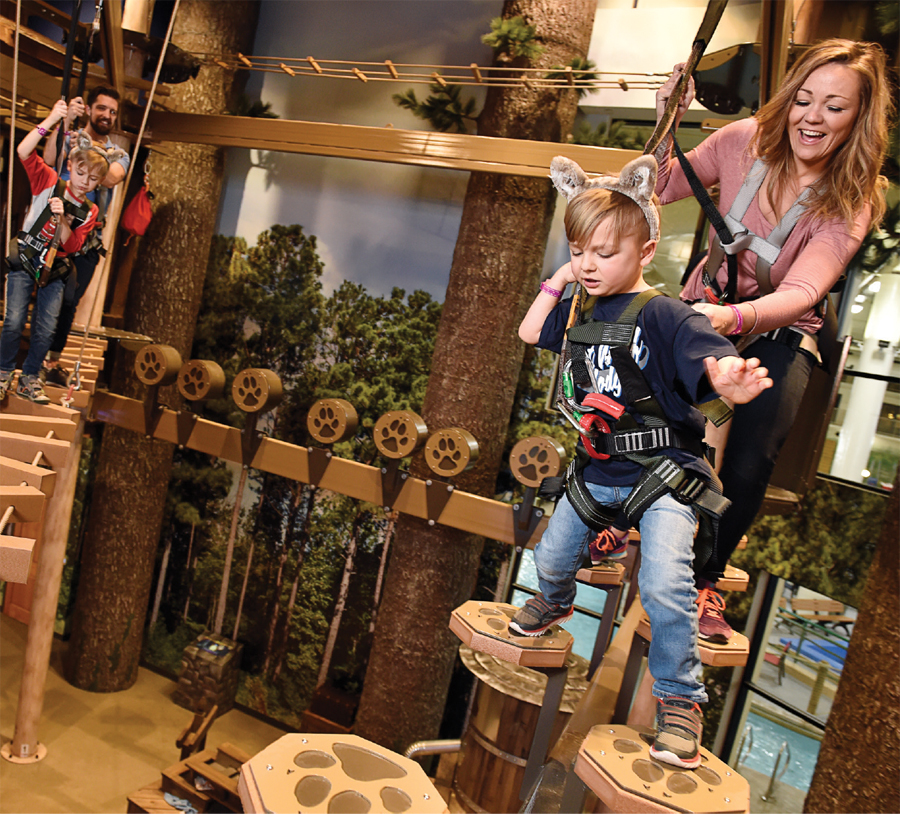 A family tackling the ropes course at Great Wolf Lodge in Bloomington, Minnesota.