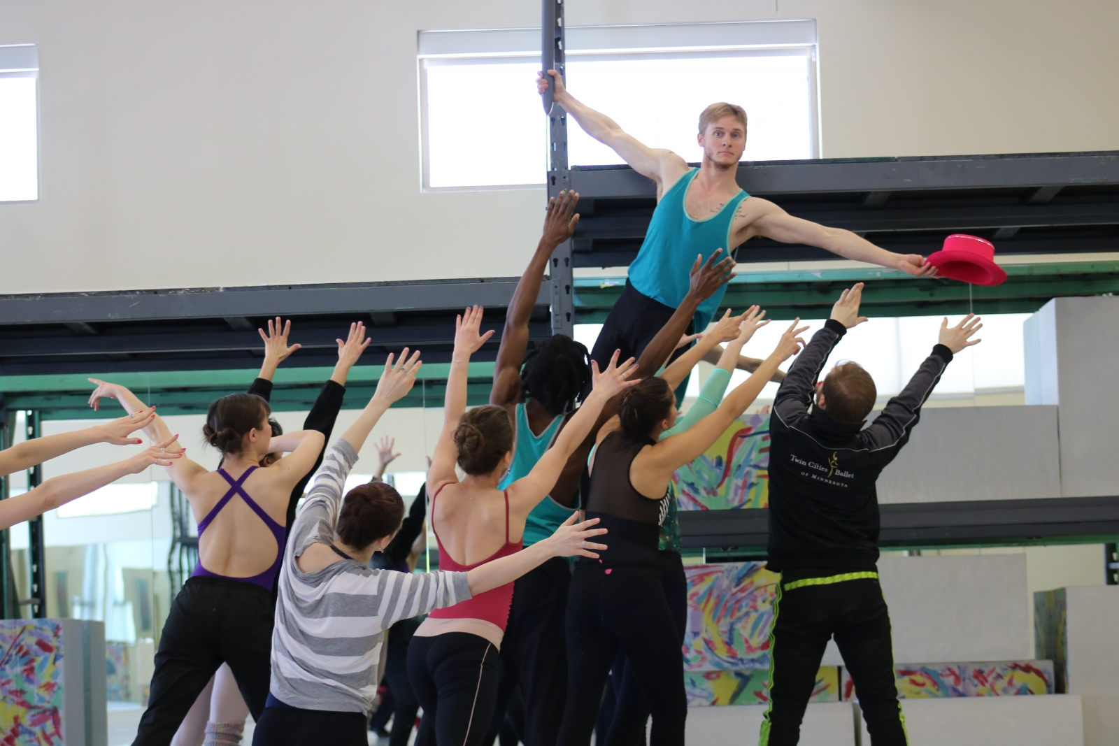 """Photo by Sarah Lopz Donovan of Luke Xavier as Pink in rehearsal with the rest of the cast for Twin Cities Ballet's """"The Wall."""""""