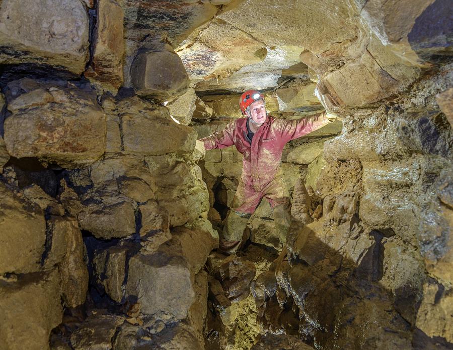John Ackerman in the upper level of Ackerman's Cave.