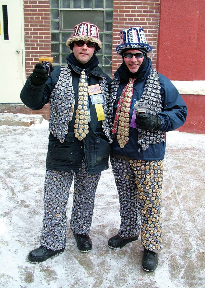 Two men standing in costumes made out of beer bottle caps at Bock Fest.