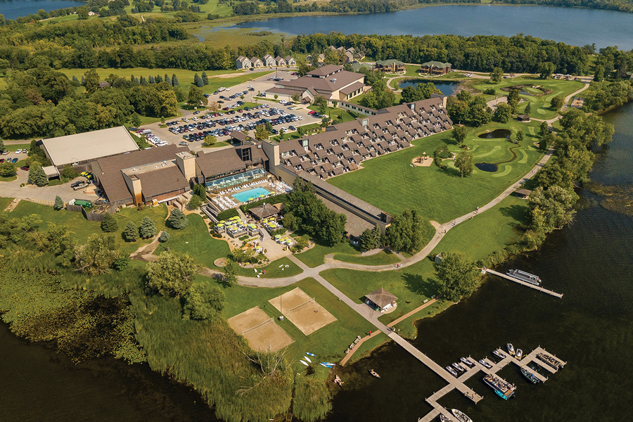 An aerial shot of Arrowwood Resort showing a pool, lake and boats in Alexandria, Minnesota.