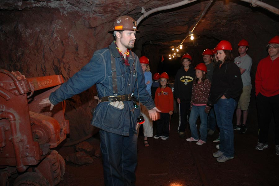 A guide giving a tour to people at the Soudan Mine.