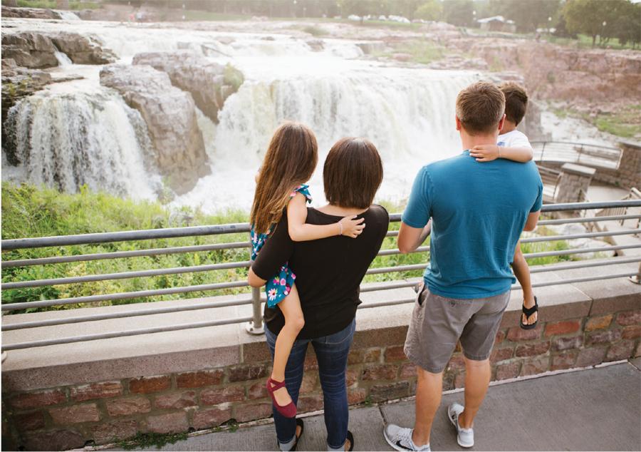 A family looking at the falls at Sioux Falls, South Dakota.