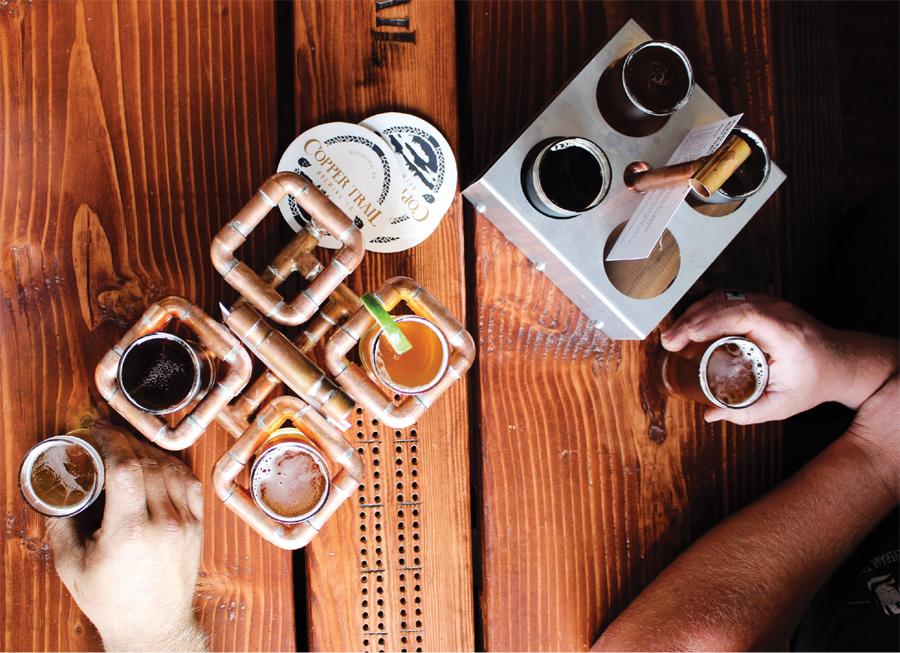 Beer flights on a wood table at Skal Crawl.