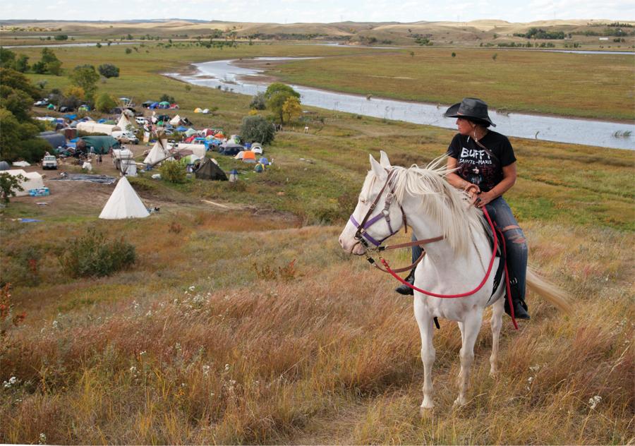Winona LaDuke overlooks protestors gathered at Sacred Stone Camp to oppose the Dakota Access Pipeline on North Dakota's Standing Rock Reservation in 2016.