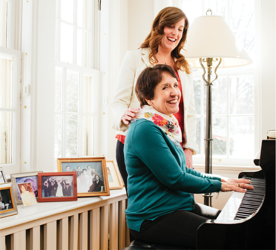 Dr. Marti Erickson playing piano with her daughter Dr. Erin Erickson.